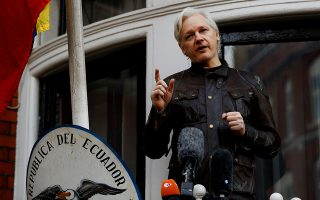 FILE PHOTO: WikiLeaks founder Julian Assange is seen on the balcony of the Ecuadorian Embassy in London, Britain, May 19, 2017. REUTERS/Peter Nicholls/File photo