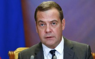Russian Prime Minister Dmitry Medvedev leads a cabinet meeting in the Gorky residence outside Moscow, Georgia, Wednesday, Aug. 29, 2018. Russian President Vladimir Putin said in a televised address Wednesday said without raising the retirement age Russia's pension system