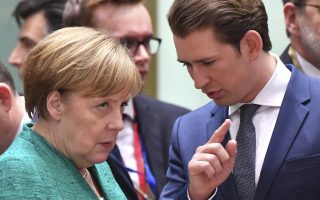 German Chancellor Angela Merkel, left, speaks with Austrian Chancellor Sebastian Kurz during a round table meeting at an EU summit in Brussels, Thursday, June 28, 2018. European Union leaders meet for a two-day summit to address the political crisis over migration and discuss how to proceed on the Brexit negotiations. (AP Photo/Geert Vanden Wijngaert)