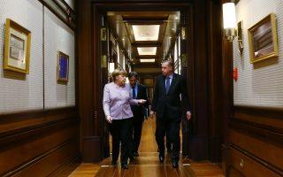 Turkey's President Recep Tayyip Erdogan, right, walks with German Chancellor Angela Merkel, left, prior to their meeting at the Presidential Palace in Ankara, Turkey, on Thursday, Feb. 2, 2017. (Presidential Press Service, Pool via AP)