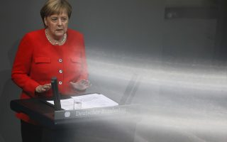 German Chancellor Angela Merkel delivers her speech during a plenary session of the German parliament Bundestag about the budget 2019, in Berlin, Wednesday, Sept. 12, 2018. (AP Photo/Markus Schreiber)