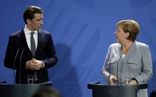 German Chancellor Angela Merkel, right, and the Chancellor of Austria, Sebastian Kurz, address the media during a statement prior to a meeting at the chancellery in Berlin, Germany, Sunday, Sept. 16, 2018. (AP Photo/Michael Sohn)