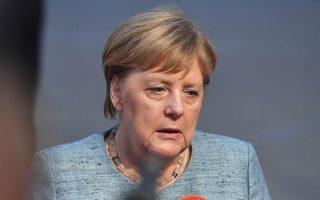 German Chancellor Angela Merkel answers questions when arriving at the informal EU summit in Salzburg, Austria, Wednesday, Sept. 19, 2018. (AP Photo/Kerstin Joensson)