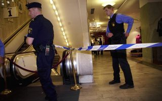 Policemen seal off an area in the NK shopping mall in central Stockholm where Swedish Foreign Minister Anna Lindh was stabbed in the stomach, chest and arm September 10, 2003.  Police said her wounds were not life-threatening and she was conscious when carried into an ambulance on a stretcher. But almost two hours after the attack she was still on the operating table at Stockholm's Karolinska hospital, her spokesman said. SWEDEN, DENMARK, NORWAY OUT, NO THIRD PARTY SALES   REUTERS/SCANPIX/Stefan Bladh