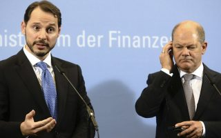 German Finance Minister Olaf Scholz, right, attends a joint press conference with Turkey's Finance and Treasury Minister Berat Albayrak at the finance ministry in Berlin, Friday, Sept. 21, 2018. (AP Photo/Markus Schreiber)
