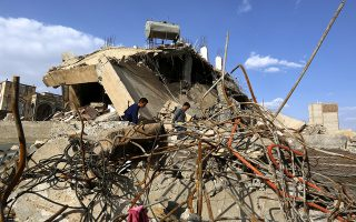 epa07006012 Yemenis walk through debris of a destroyed building allegedly hit by a previous Saudi-led airstrike, in Sana'a, Yemen, 08 September 2018. According to reports, UN Special Envoy for Yemen Martin Griffiths will have meetings in the coming days with Houthi representatives in Oman and Sana'a after the Houthi's failure to attend the Geneva peace talks. Yemen remains wracked by the conflict since March 2015 when the Saudi-led coalition launched an airstrike campaign aiming at rolling back the Houthi rebels' gains in Yemen, plunging the Arab country into the world's worst humanitarian crisis.  EPA/YAHYA ARHAB