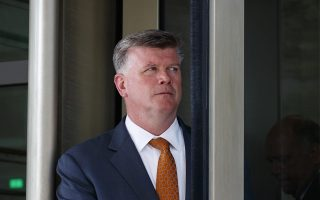 Attorney Kevin Downing, with the defense team for Paul Manafort, leaves federal court in Washington, Tuesday, Aug. 28, 2018, after he and others gave a preview of cases as they argue over how much jurors will be allowed to hear of the former Trump campaign chairman's lengthy foreign lobbying career. (AP Photo/Carolyn Kaster)