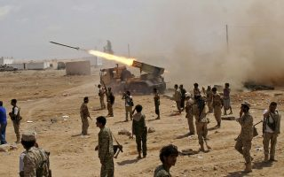 FILE - Yemeni army soldiers fire rockets at mountainous positions of al-Qaida militants at the town of Meyfaa in the southern province of Shabwa, Yemen in May 2014 file photo provided by Yemen's Defense Ministry. Al-Qaida took over multiple towns in Shabwa in 2015 and held them until they withdrew in late 2017 and early 2018. The AP found that they pulled out under secret deals with the U.S.-backed coalition that allowed them to take weapons and cash with them, integrated some of its fighters into coalition-backed forces and even paid off some militants. (AP Photo/Yemen's Defense Ministry, File)