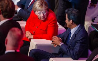 epa07002513 German Chancellor Angela Merkel (L) and the Emir of Qatar, Sheikh Tamim bin Hamad Al Thani, chat with each other as they take part in the 'Qatar-Germany Forum For Business And Investment' in Berlin, Germany, 07 September 2018. The forum, described as a cross-continental event, according to its organizers gathers high government officials, businessmen and major company representatives from both countries.  EPA/JENS SCHLUETER