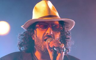 Algerian singer Rachid Taha sings on the main stage during the opening day of the Paleo Festival in Nyon, Switzerland, late Tuesday, July 19, 2005. (AP Photo/Keystone, Sandro Campardo)