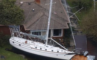 A sailboat is shoved up against a house and a collapsed garage Saturday, Sept. 15, 2018, after heavy wind and rain from Florence, now a tropical storm, blew through New Bern, N.C. (AP Photo/Steve Helber)