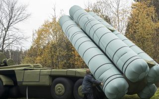 Employees install an inflatable full size model of S-300 missile system in the yard of the Rusbal balloon developing company in a town of Khotkovo, about 60 kilometers (37,28 miles) northeast Moscow, Russia, Friday, Oct. 14, 2016. Rusbal company develops hot air balloons and inflatable models of weapons used for military festivals. (AP Photo/Pavel Golovkin)