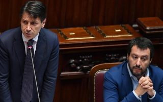 epa06789149 Italian premier Giuseppe Conte (C), flanked by Interior Minister Matteo Salvini (R) and Labor Minister Luigi Di Maio (L), during his address to the Lower House ahead of a confidence vote, in Rome, Italy, 06 June 2018. 'Politics should take back its proper role in the economy without dirigisme,' premier Conte said. 'We want to trace the lines of development because we have a project for the future,' he added.  EPA/ETTORE FERRARI