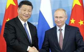 Russian President Vladimir Putin, right, shakes hands with Chinese President Xi Jinping during a signing ceremony following their talks at the Eastern Economic Forum in Vladivostok, Russia, Tuesday, Sept. 11, 2018. (Sergei Chirikov/Pool Photo via AP)