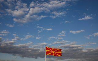 A Macedonian flag flutters on one day before the referendum on changing the country's name that would open the way for it to join NATO and the European Union, in Skopje, Macedonia September 29, 2018. REUTERS/Marko Djurica
