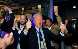 The member of the EU parliament Lars Adaktusson cheers over the results from the exit poll in Stockholm, Sweden September 9, 2018. TT News Agency/ Jessica Gow/via REUTERS      ATTENTION EDITORS - THIS IMAGE WAS PROVIDED BY A THIRD PARTY. SWEDEN OUT. NO COMMERCIAL OR EDITORIAL SALES IN SWEDEN.