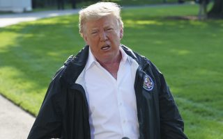 President Donald Trump gestures as he talks to media before boarding Marine One on the South Lawn of the White House in Washington, Wednesday, Sept. 19, 2018, for the short trip to Andrews Air Force Base en route to Havelock, N.C. (AP Photo/Carolyn Kaster)