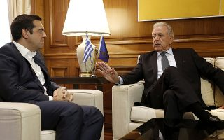 epa07031843 Greek Prime Minister Alexis Tsipras (L) talks with Dimitris Avramopoulos (R), EU Commissioner for Migration, Home Affairs and Citizenship during their meeting at the Maximos Mansion in Athens, Greece, 19 September 2018.  EPA/ALEXANDROS VLACHOS