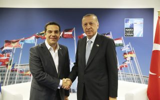 Turkey's President Recep Tayyip Erdogan, right, shakes hands with Greece's Prime Minister Alexis Tsipras, prior to their talks on the sidelines of a summit of heads of state and government at NATO headquarters in Brussels, Thursday, July 12, 2018. NATO leaders gathered in Brussels for a two-day summit to discuss subjects including  Russia, Iraq and their mission in Afghanistan. (Presidency Press Service via AP, Pool)