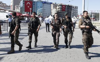 epa05435047 Members of a Turkish SWAT team on duty at Taksim Square, in Istanbul, Turkey, 21 July 2016. Turkish President Recep Tayyip Erdogan has declared a three-month state of emergency and caused the dismissal of 50,000 workers and the arrest of 8,000 people after the 15 July failed coup attempt. At least 290 people were killed and almost 1,500 injured amid violent clashes on 15 July as certain military factions attempted to stage a coup d'etat. The UN and various governments and organizations have urged Turkey to uphold the rule of law and to defend human rights.  EPA/SEDAT SUNA