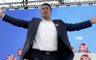 Macedonian Prime Minister Zoran Zaev greets the supporters during a pre-referendum rally named