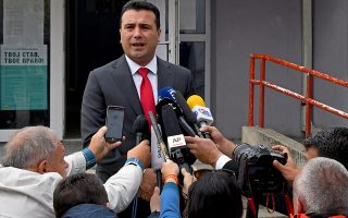 epa07058231 FYR of Macedonia Prime Minister Zoran Zaev speaks to journalits during a referendum on the country's name change at a polling station in the town of Strumica, The Former Yugoslav Republic of Macedonia (FYROM), 30 September 2018. Almost two million Macedonians will vote in a national referendum on 30 September, on whether to change the country's name to 'North Macedonia' to endorse a name deal between FYR of Macedonia and Greece and to qualify for NATO membership.  EPA/GEORGI LICOVSKI
