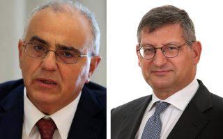 Ο πρόεδρος της Ελληνικής Ένωσης Τραπεζών (ΕΕΤ), Νικόλαος Καραμούζης (Δ) και ο διευθύνων σύμβουλος της Εθνικής Τράπεζας, Παύλος Μυλωνάς.