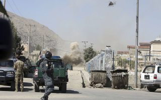 An MD 530F military helicopter targets a house where attackers are hiding in Kabul, Afghanistan, Tuesday, Aug. 21, 2018. The Taliban fired rockets toward the presidential palace in Kabul Tuesday as President Ashraf Ghani was giving his holiday message for the Muslim celebrations of Eid al-Adha, said police official Jan Agha. (AP Photo/Rahmat Gul)