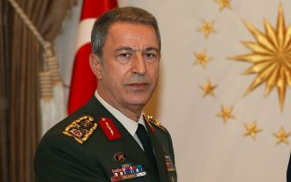 Turkey's President Tayyip Erdogan (R) receives newly appointed Chief of Staff General Hulusi Akar at the Presidential Palace in Ankara, Turkey, August 19, 2015. Turkey is heading rapidly towards a new election and only a solution involving the