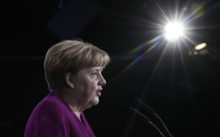 German Chancellor and party chairwoman Angela Merkel delivers her speech at the party convention of the Christian Democratic Union CDU in Berlin, Germany, Monday, Feb. 26, 2018. The delegates came together to decide on the coalition agreement on forming a new German government. (AP Photo/Markus Schreiber)