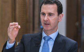 In this photo released on Wednesday, June 13, 2018 by the Syrian official news agency SANA, Syrian President Bashar Assad speaks during an interview with Iran's Al Alam TV, in Damascus, Syria. Assad says Iran's presence in Syria and its relations with Damascus are not negotiable and repeated the assertion that Iran has no fixed bases in Syria. (SANA via AP)
