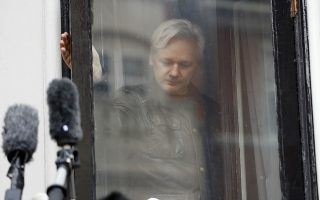 FILE - In this Friday May 19, 2017 file photo, WikiLeaks founder Julian Assange leaves after greeting supporters outside the Ecuadorian embassy in London. The Associated Press found powerful evidence of a direct link between Fancy Bear hackers and the interlocking leakers WikiLeaks, Guccifer 2.0 and DCLeaks. All the Democrats whose private correspondence was published in the run-up to the 2016 U.S. election were targeted by Fancy Bear. (AP Photo/Frank Augstein)