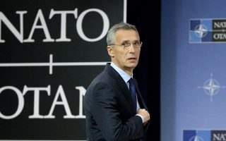 FILE - In this Nov. 7, 2017 file photo, NATO Secretary General Jens Stoltenberg arrives for a media conference at NATO headquarters in Brussels. NATO is giving Stoltenberg two more years at the head of the world's biggest military alliance, according to a NATO's statement, Tuesday, Dec. 12, 2017. (AP Photo/Virginia Mayo, File)