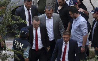 US Pastor Andrew Brunson, second left, arrives at home after his release, following his trial in Izmir, Turkey, Friday, Oct. 12, 2018, A Turkish court on Friday convicted an American pastor of terror charges but released him from house arrest and allowed him to leave Turkey, in a move that is likely to ease tensions between Turkey and the United States. (AP Photo/Emre Tazegul)