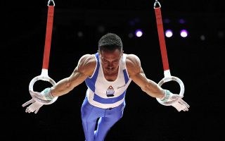 Eleftherios Petrounias of Greece on his way to winning the gold medal in the rings during the men's artistic gymnastics finals at the European Championships in Glasgow, Scotland, Sunday, Aug. 12, 2018. (AP Photo/Darko Bandic)
