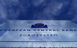 Water droplets from melting ice are seen on the entrance sign of the new European Central Bank (ECB) headquarters in Frankfurt January 21, 2015. The ECB governing council will meet on Thursday.   REUTERS/Kai Pfaffenbach (GERMANY - Tags: BUSINESS POLITICS)