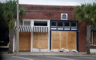FILE PHOTO: A boarded up business is pictured as Hurricane Michael bears down on Carrabelle, Florida, U.S., October 9, 2018. REUTERS/Carlo Allegri/File Photo