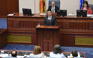 epa07094459 Macedonian Prime Minister Zoran Zaev  addresses members of the parliament at the beginning of the parliamentary session on changing the state's constitution in Skopje, The Former Yugoslav Republic of Macedonia (FYROM), 15 October 2018. After the referendum held on September 30, the FYROM government submits a proposal to the parliament for the change of the state's constitution, to change the country's name to 'Republic of Northern Macedonia' to endorse a name deal between FYR of Macedonia and Greece and to qualify for NATO membership. It is necessary to have two third majority, (80 members of the parliament) to change the constitution of the state.  EPA/GEORGI LICOVSKI