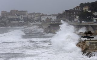 Giant waves crash against the sea defenses in Marseille, southern France, Monday, Dec.11, 2017. Most of the French regions are on alert for violent storms, high winds and high coastal waves. (AP Photo/Claude Paris)