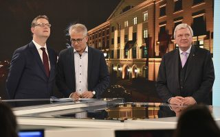 Top candidates of the Social Democratic party SPD, Thorsten Schaefer-Guembel, Greens, Tarek Al-Wazir, and Christian Democrats, governor Volker Bouffier, from left, arrive in a TV studio after the state election in the German state of Hesse in Wiesbaden, western Germany, Sunday, Oct. 28, 2018.  Germany's governing parties lost significant support in a state election Sunday marked by discontent with infighting in the national government, according to projections. (Oliver Dietze/pool photo via AP)