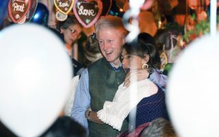Former US President Bill Clinton, left and and guest celebrate, in the K'fer marquee during the Oktoberfest, in Munich, Germany, Friday, Oct. 5, 2018. The biggest folk festival in the world takes place from Sept 22 - Oct. 7. (Tobias Hase/dpa via AP)