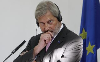 European Union's enlargement commissioner Johannes Hahn looks on during a news conference with Macedonian Prime Minister Zoran Zaev, following their meeting in Skopje, Macedonia, Tuesday, Sept. 18, 2018.  Hahn has urged Macedonians to back a name deal referendum planned for the end of this month that will change the country name to