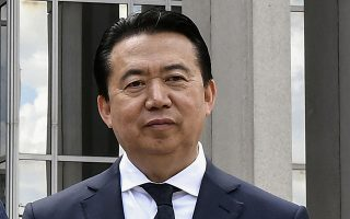 INTERPOL President Meng Hongwei poses during a visit to the headquarters of International Police Organisation in Lyon, France, May 8, 2018. Picture taken May 8, 2018.   Jeff Pachoud/Pool via Reuters