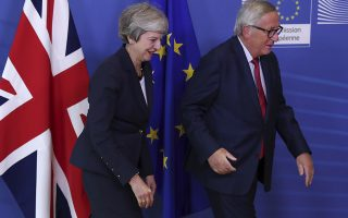British Prime Minister Theresa May, left, and Jean-Claude Juncker, President of the European Commission, leave after a photo opportunity as they meet in Brussels, Wednesday, Oct. 17, 2018 when European leaders meet to negotiate on terms of Britain's divorce from the European Union. (AP Photo/Francisco Seco)