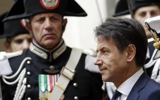 Italian Premier Giuseppe Conte arrives for a meeting with Romanian President Klaus Iohannis, in Rome's Chigi Palace Italian government's office, Monday, Oct. 15, 2018. (AP Photo/Andrew Medichini)