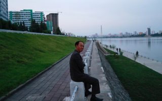 A man sits along the Taedong river in Pyongyang, North Korea, September 12, 2018. REUTERS/Danish Siddiqui