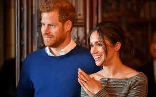 FILE PHOTO: Britain's Prince Harry and his fiancee Meghan Markle watch a performance by a Welsh choir in the banqueting hall during a visit to Cardiff Castle in Cardiff, Britain, January 18, 2018. REUTERS/Ben Birchall/Pool/File Photo