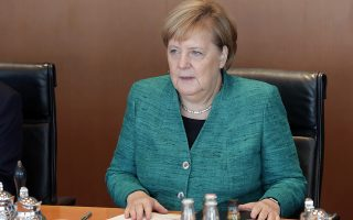 German Chancellor Angela Merkel attends the weekly cabinet meeting at the chancellery in Berlin, Germany, Tuesday, Oct. 2, 2018. (AP Photo/Michael Sohn)
