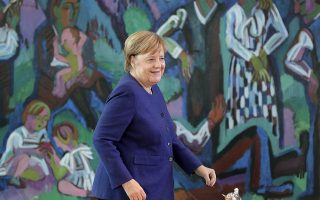 German Chancellor Angela Merkel arrives for the weekly cabinet meeting at the chancellery in Berlin, Germany, Wednesday, Sept. 26, 2018. (AP Photo/Michael Sohn)