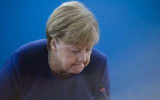 German Chancellor Angela Merkel takes her seat prior to a Christian Democratic Union party's leaders meeting at the party's headquarters a day after the Bavarian state elections, in Berlin, Monday, Oct. 15, 2018. (AP Photo/Markus Schreiber)